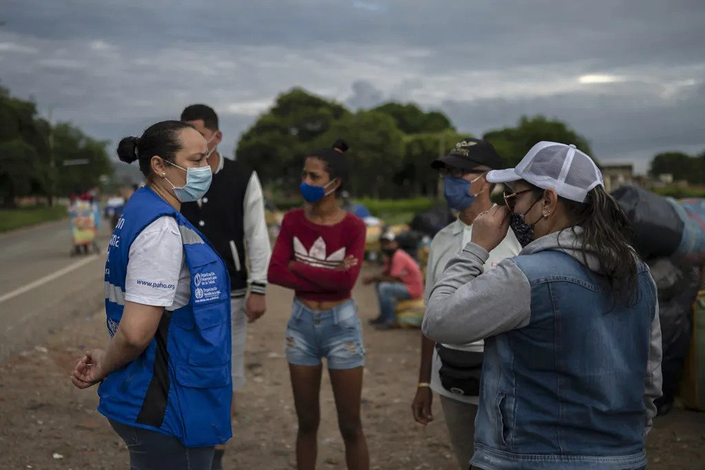 A VIRUS THAT RESPECTS NO BORDERS: PROTECTING REFUGEES AND MIGRANTS DURING COVID-19